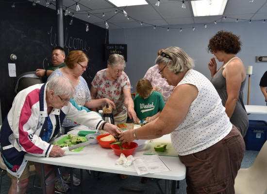 Participants work together to recreate the class dish.
