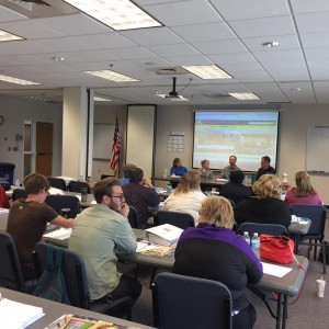 Producers and businesses attending the Institutional Buying Event, listening to a panel of local food buyers, including the Buffalo Community Middle School.
